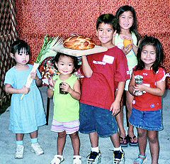 A few of the children of the Asian-American Havurah celebrate Sukkot. Photo by Alicia Messing