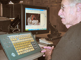 Al Plotkin views his days-old great-granddaughter via e-mail on a new computer system at Kivel Campus of Care.