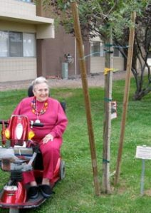Sherrill Moore visits a tree she donated about six months ago at Kivel Campus of Care's assisted-living facility.