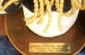 The Czech Memorial Scrolls are identified by a small metal plate on the eitz chayim (the wooden handles). Photo by Lee Shedroff
