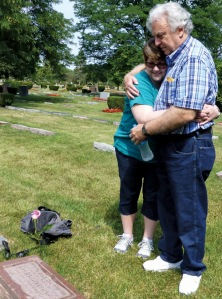 Sharon Kahn visits the grave of her birth mother during her recent trip to Chicago. She's pictured here with Jack Decker, her birth father, whom she met for the first time during this trip.